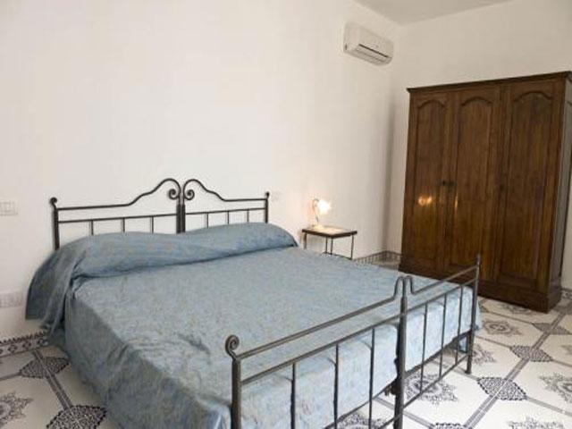 Camera da letto matrimoniale all'interno delle case vacanza