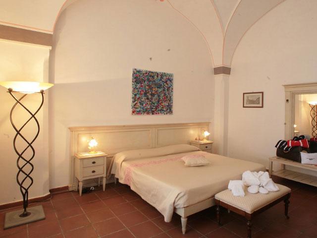 Camere finemente arredate all'interno di Borgo Cardigliano