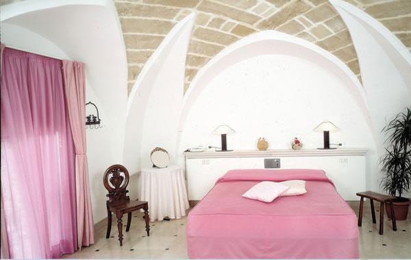 Camere da letto dell'Hotel Hyencos a Ugento