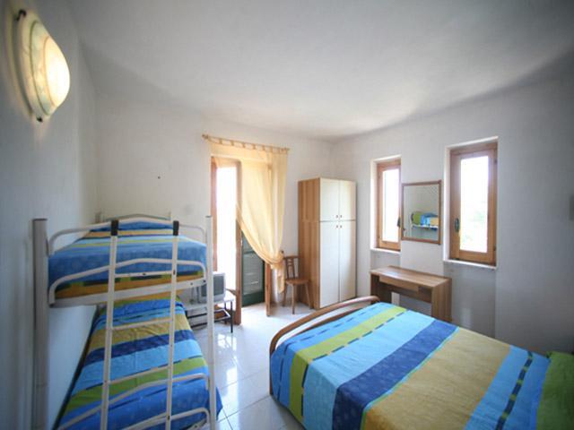 Camera da letto del bilocale - Residence gli Stingi