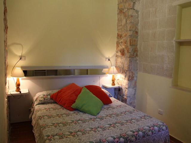 Camera da letto degli appartamenti trilocali