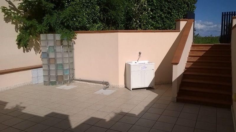 lo spazio esterno accessibile dall'appartamento al piano basso