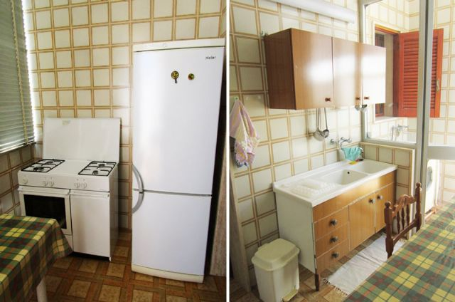 cucinotto con frigo e freezer, lavello, cucina a gas e lavatrice