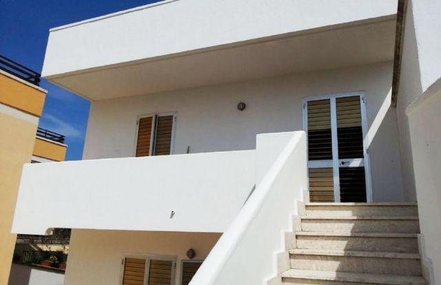 la scala per accedere alla casa vacanza posta al primo piano