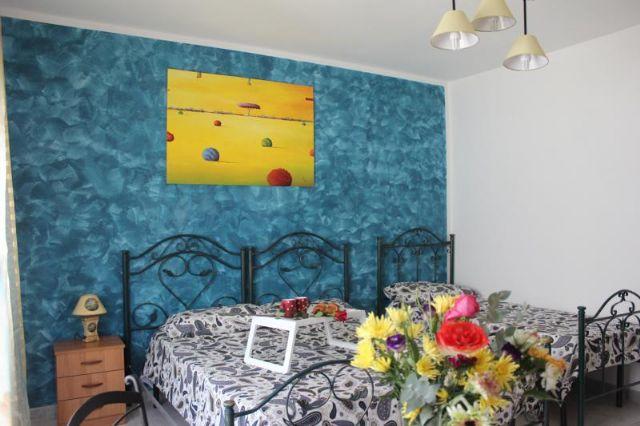 eleganti stanze ben arredate e rifinite