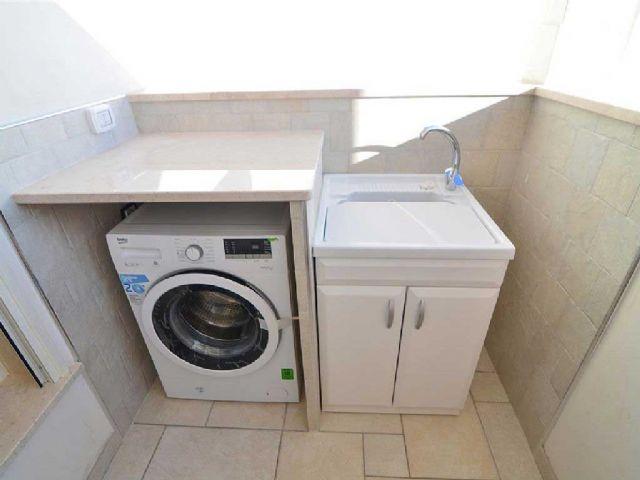 lavatrice e tinozza