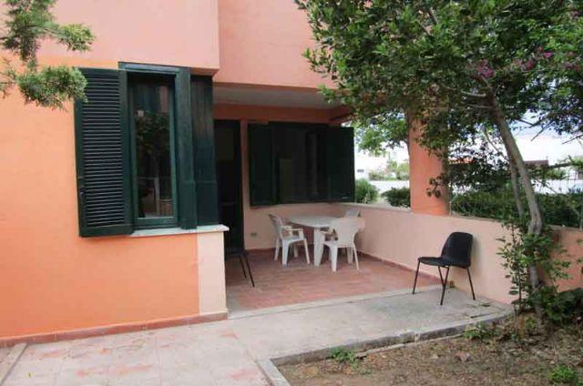 veranda con zona pranzo all'aperto sul fronte della casa vacanza