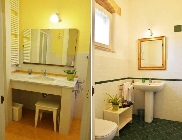 il bagno con articoli da toilette in omaggio, asciugacapelli, doccia o vasca