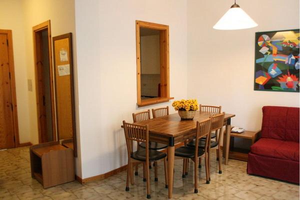 Zona soggiorno dell'appartamento per cinque o sei persone